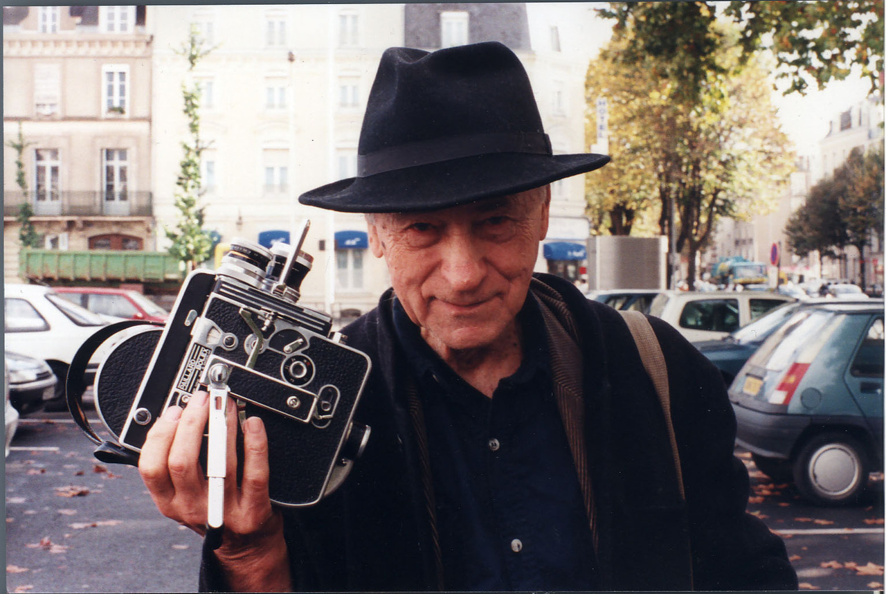 Jonas Mekas in New York 2010 holding his 16 mm Bolex camera. Photo by Alexei Dimitriev.